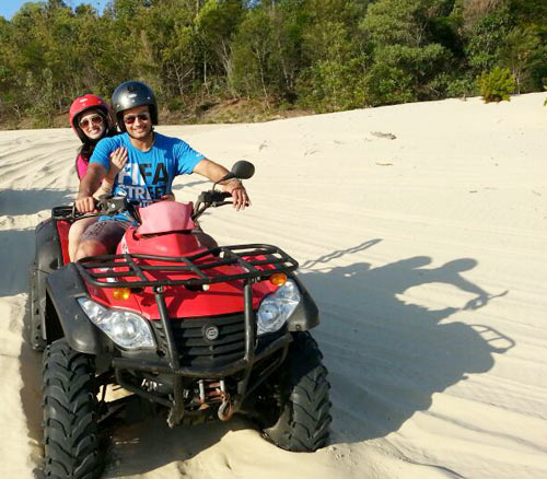 Vivian and Vahbbiz Dsena on the ATV bike