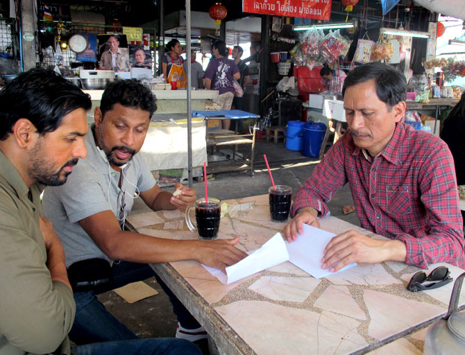 John Abraham, Shoojit Sircar and Dibang on the sets of Madras Cafe