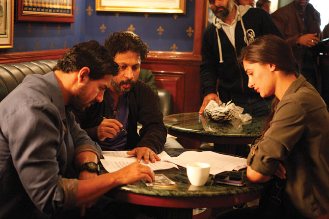 John Abraham, Shoojit Sircar and Nargis on the sets of Madras Cafe