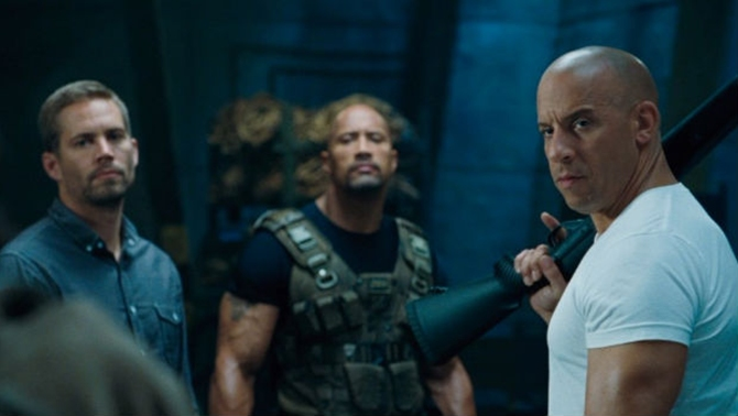 Paul Walker and Vin Diesel with Dwayne Johnson in The Fast And The Furious