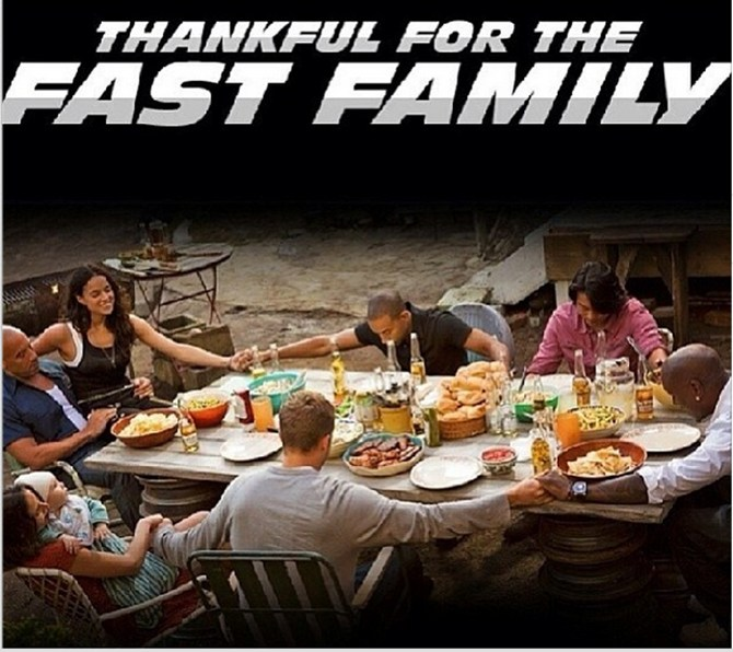 Paul Walker (in a grey t-shirt) celebrates Thanksgiving on the sets of a Fast And Furious film