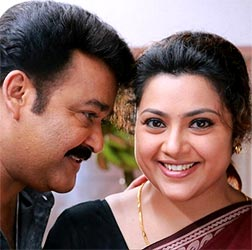 Current Bollywood News & Movies - Indian Movie Reviews, Hindi Music & Gossip - Review: Drishyam is Mohanlal's film