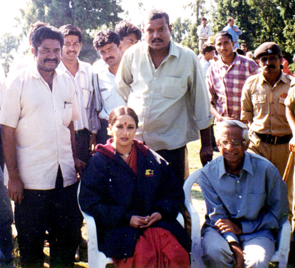 Madhuri Dixit relaxes with crew members on the sets of Wajood