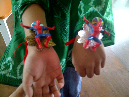 Czar shows off his Spiderman rakhis