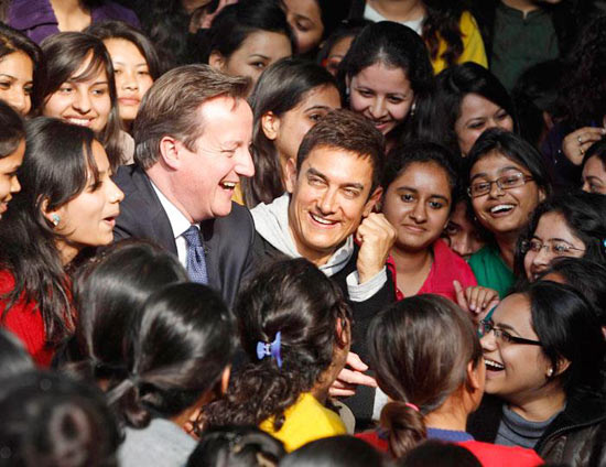 Aamir Khan and British Prime Minister David Cameron, surrounded by students