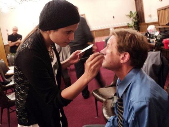 Ritu Janjjani applies make-up to an actor