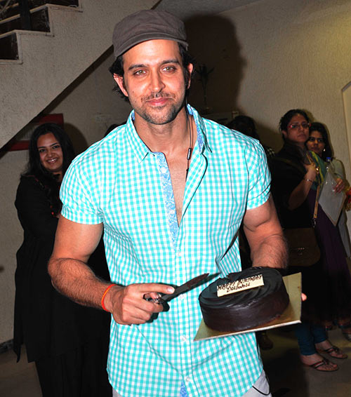 Hrithik Roshan with his birthday cake at his residence