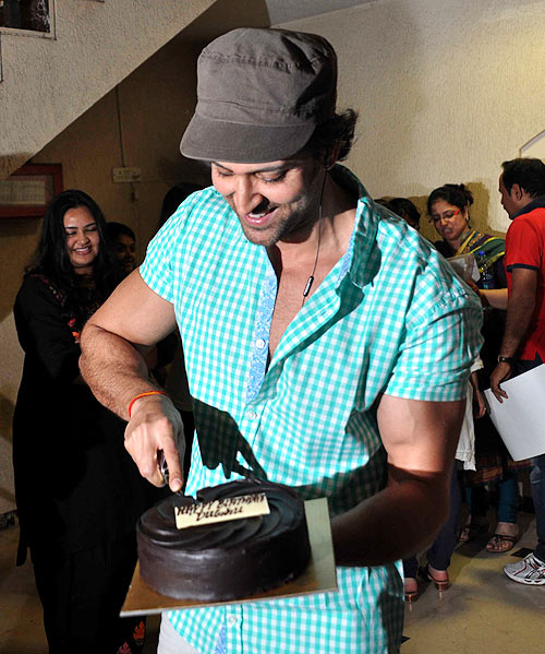 Hrithik Roshan cutting his birthday cake