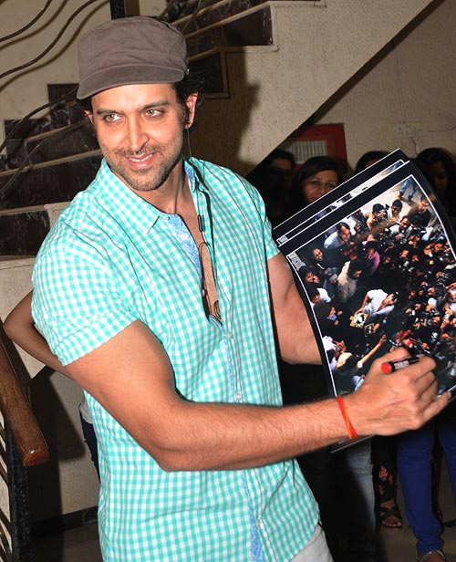 Hrithik Roshan signs a fan photograph