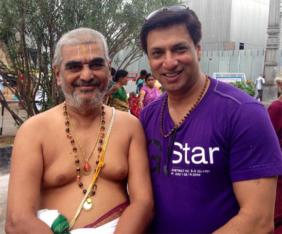 Madhur Bhandarkar with the priest at Tirupati