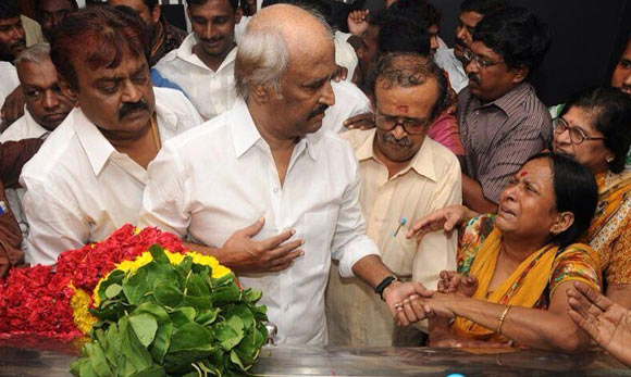 Rajinikanth (centre) with Vijayakanth to his right