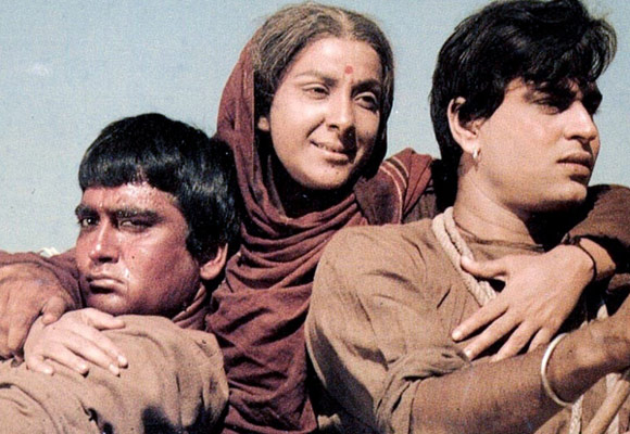 Sunil Dutt, Nargis and Rajendra Kumar in Mother India