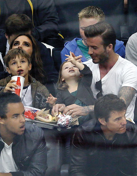 Victoria, Romeo, Harper and David Beckham. In the front: Connor and Tom Cruise