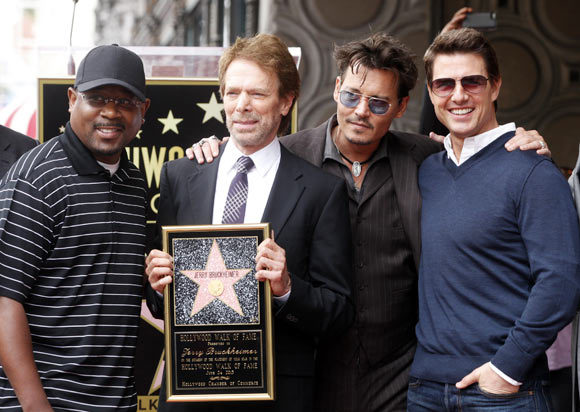 Martin Lawrence, Johnny Depp and Tom Cruise  pose with film and television producer Jerry Bruckheimer