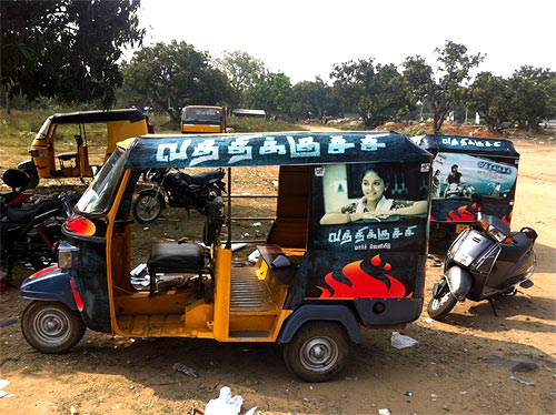An autorickshaw with the poster of Vathikuchi