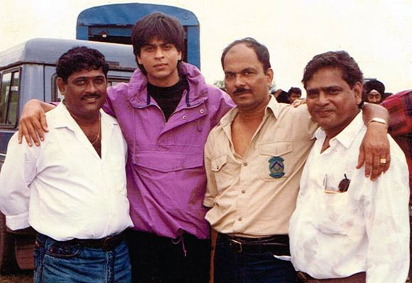 Shashikant Mhatre, second from right, with Shah Rukh Khan on an ad shoot