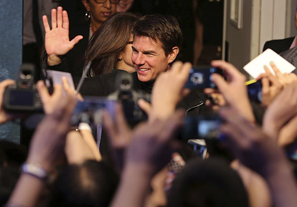 Tom Cruise waves to his fans