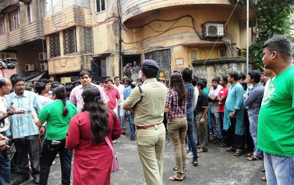 People outside Rituparno Ghosh's Kolkata home