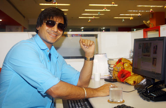 Vivek Oberoi takes a break from the Rediff Chat to smile at the camera