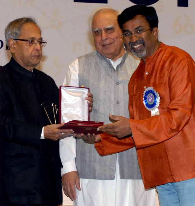 Director P Seshadri receives the National Award from President Pranab Mukherjee.