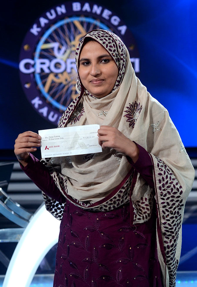 Firoz Fatma shows off her cheque