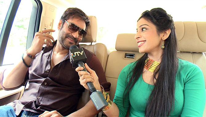 Ajay Devgn with host Garima