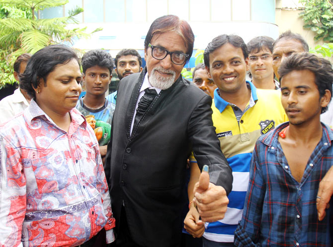 A fan dresses up as Amitabh Bachchan