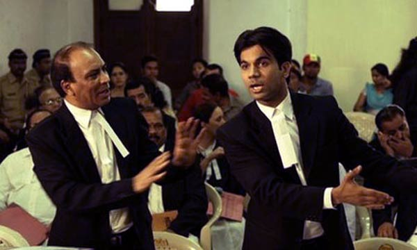 Vipin Sharma and Raj Kumar in a scene from Shahid