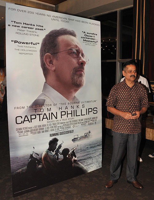 Commander-in-Chief, Western Naval Command, Shekhar Sinha poses with the poster of Captain Philips