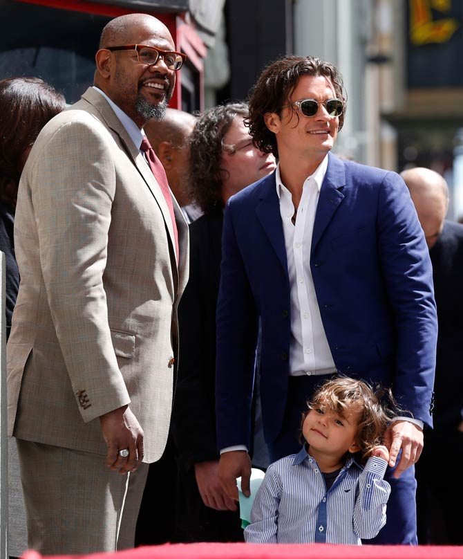 Orlando Bloom and Flynn with Forest Whitaker