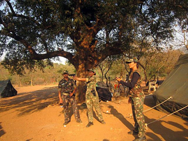 Deepika Singh pratices rifle shooting while Maninee Mishra looks on, on the sets of Diya Aur Baati Hum