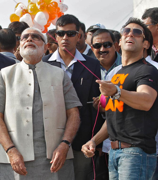 Narendra Modi looks on as Salman Khan flies a kite during a festival in Ahmedabad In January 2014