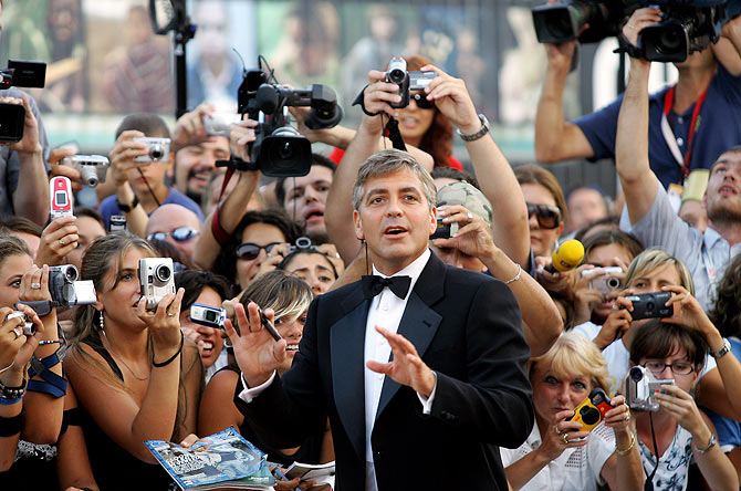 George Clooney signs autographs as he arrives at the Cinema Palace in Venice in 2005.