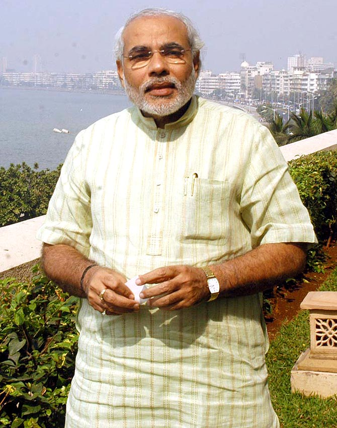 Narendra Modi in Mumbai. Behind him is the famed Marine Drive.
