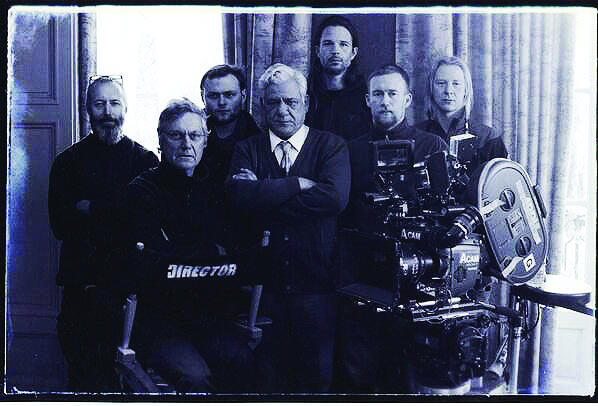 Director Lasse Hallstrom with Om Puri and the crew of The Hundred-Foot Journey.