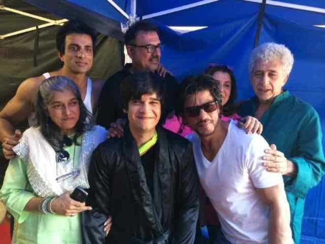 Vivaan Shah with Happy New Year cast and his parents (both in green)
