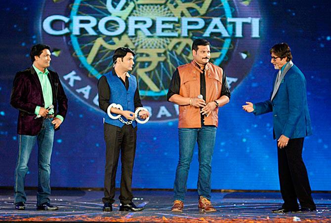 Aditiya Srivastav and Dayanand Shetty of CID along with Kapil Sharma and Amitabh Bachchan at the premiere of Kaun Banega Crorepati