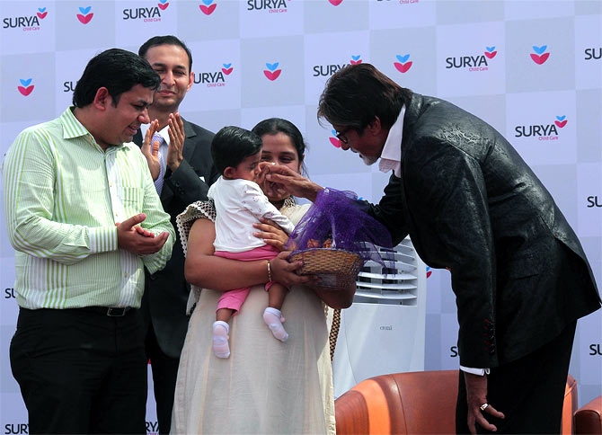 Amitabh Bachchan plays with a kid at Surya Hospital