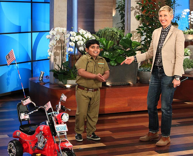 Akshat with Ellen DeGeneres and his new bike
