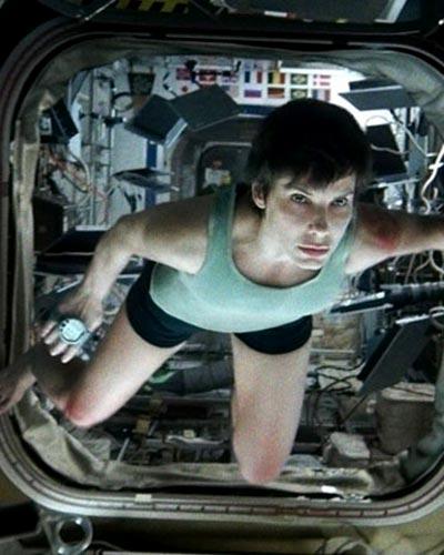 Sandra Bullock in Gravity, inset: Alsonso Cuaron