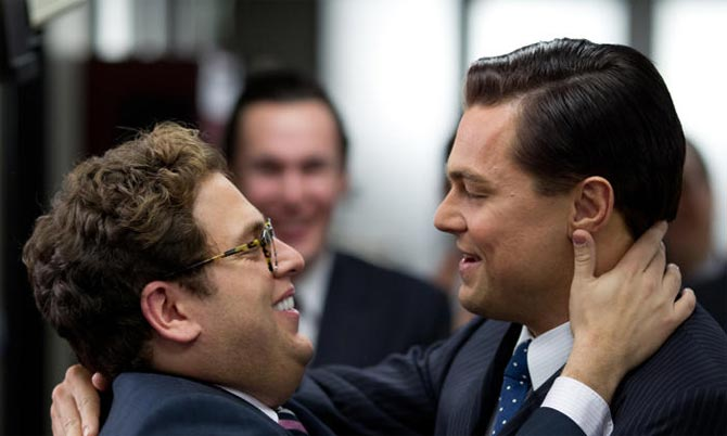 Jonah Hill and Leonardo DiCaprio in The Wolf Of Wall Street, inset: director Alfonso Cuaron