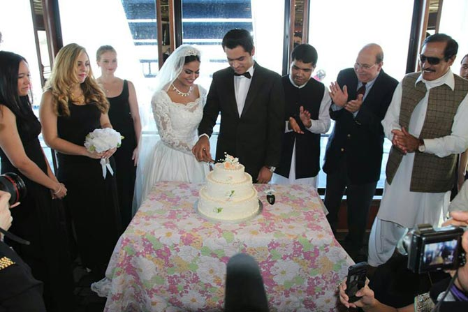 Veena Malik and Asad Khan Khattak, surrounded by bridesmaids and other guests