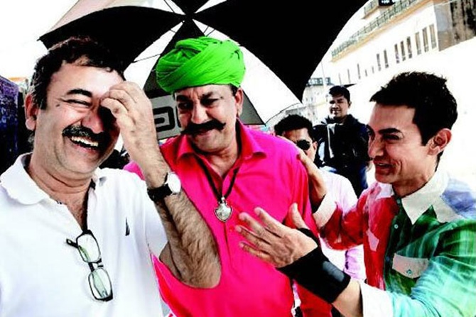 Rajkumar Hirani, Sanjay Dutt and Aamir Khan on the sets of Peekay