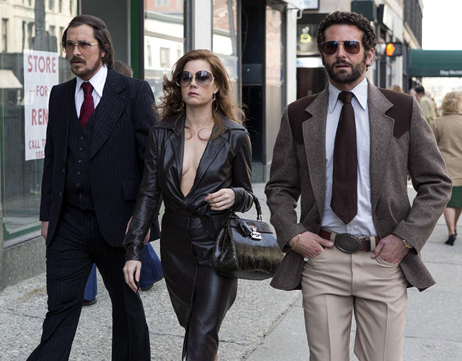Christian Bale, Amy Adams and Bradley Copper in American Hustle