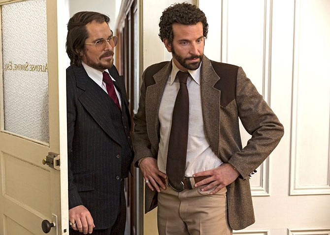 Christian Bale, Bradley Copper in American Hustle