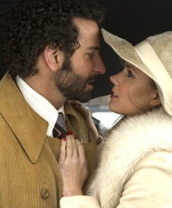 Bradley Cooper and Jeniffer Lawernce in American Hustle