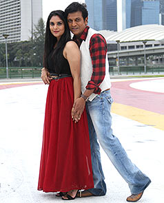Shivarajkumar and Ramya in a still from Aryan