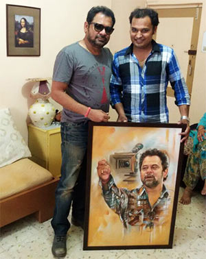 Anees Bazme poses with Prashant, who painted his portrait