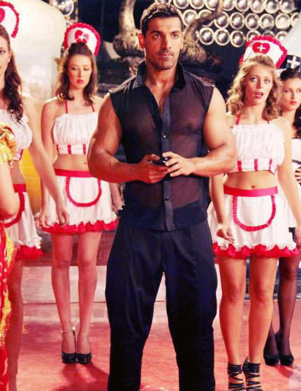 John Abraham in the song Rum-Whisky from Vicky Donor, inset Abhishek Arora