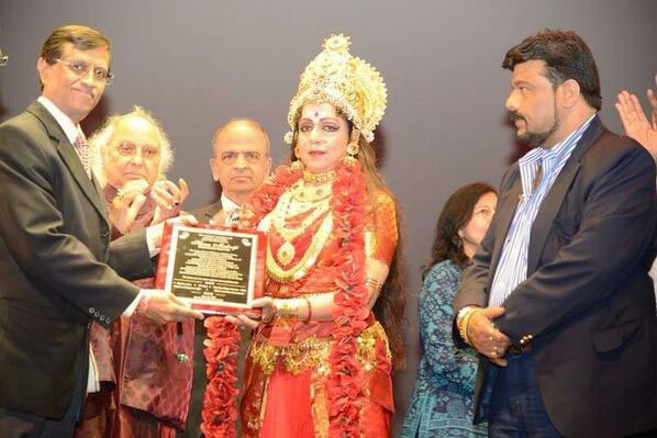 Hema Malini accepts a plaque after her performance in New Jersey
